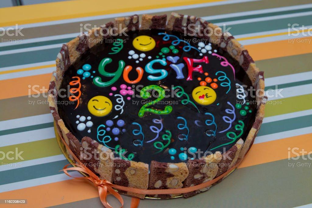 Black cake 2 year old Yusuf writing. Chocolate cake with black glaze...