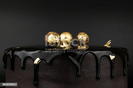 istock Chocolate cake with black glaze 965696832