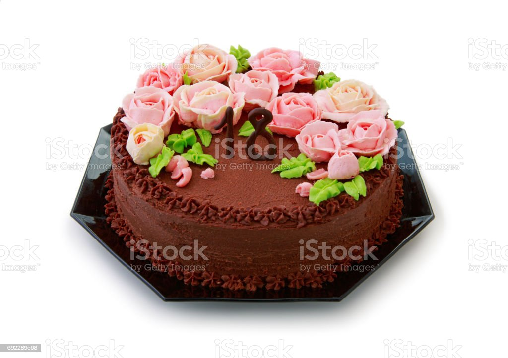 Chocolate cake with butter cream roses for the 18th birthday stock photo