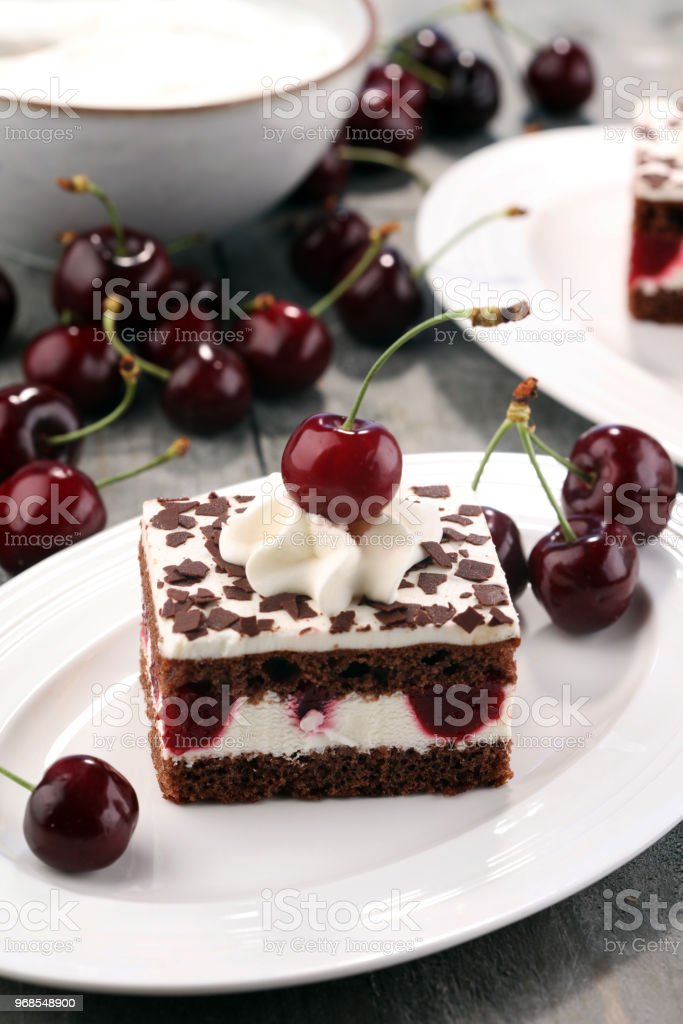 Chocolate cake with cherries and whipped cream. Black Forest cake.
