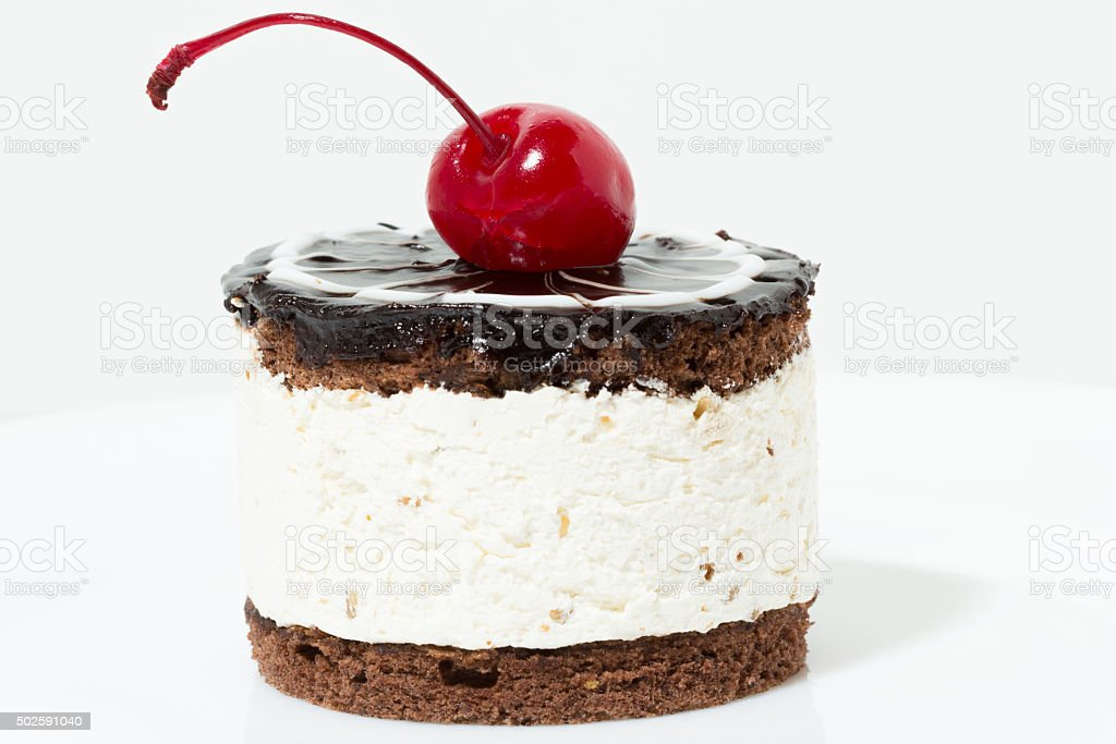 Chocolate cake with cherry on the top icing stock photo