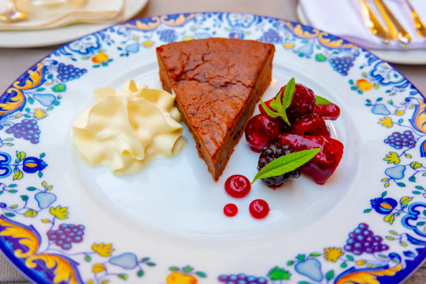 Chocolate Cake with Cream and Fruits stock photo