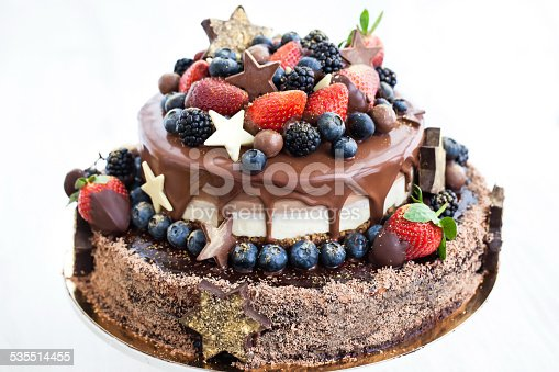 472311978 istock photo Chocolate cake with icing, decorated fresh fruit 535514455