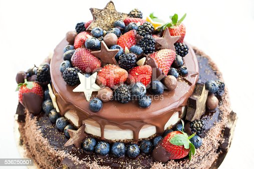 472311978 istock photo Chocolate cake with icing, decorated  fresh fruit 536250501