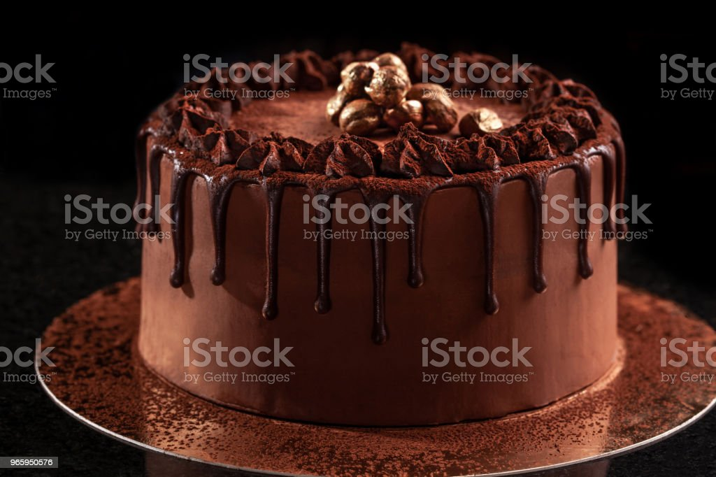 Chocolate cake with nuts on a black background - Royalty-free Backgrounds Stock Photo