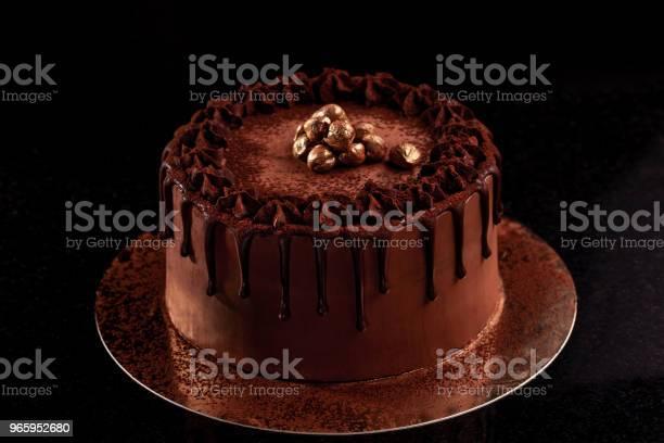 Chocolate Cake With Nuts On A Black Background - Fotografias de stock e mais imagens de Açúcar