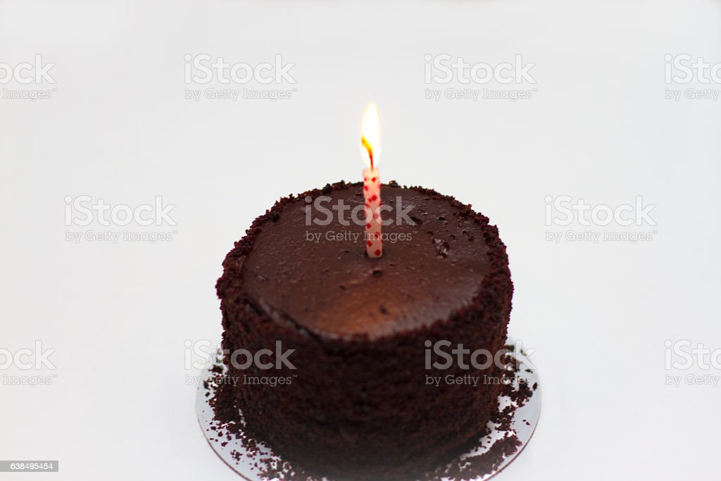 Chocolate Cake With One Lit Birthday Candle Royalty Free Stock Photo