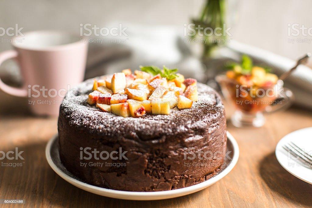 Chocolate cake with peach jam stock photo