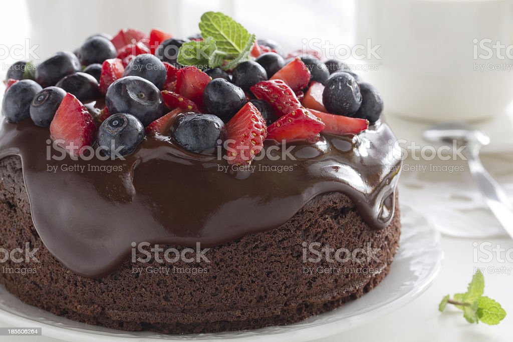 Chocolate cake with summer berries. stock photo