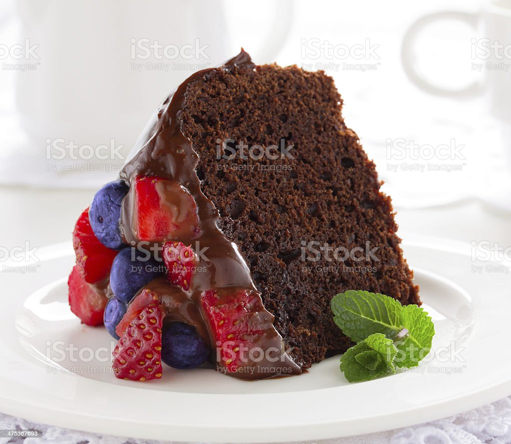 Chocolate cake with summer berries. stock photo