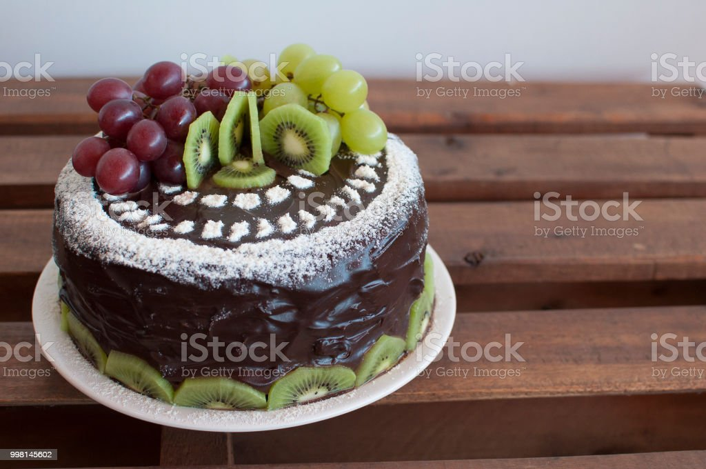 Details of chocolate cake with tropical fruits, chocolate with grape,...