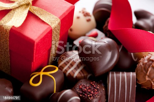 Chocolate Candies and Gift Box. Selective Focus.