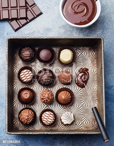 istock Chocolate candies in a vintage baking dish with chocolatier tool 621584354