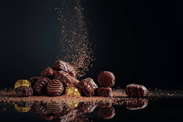 Chocolate candies sprinkled with chocolate chips. stock photo