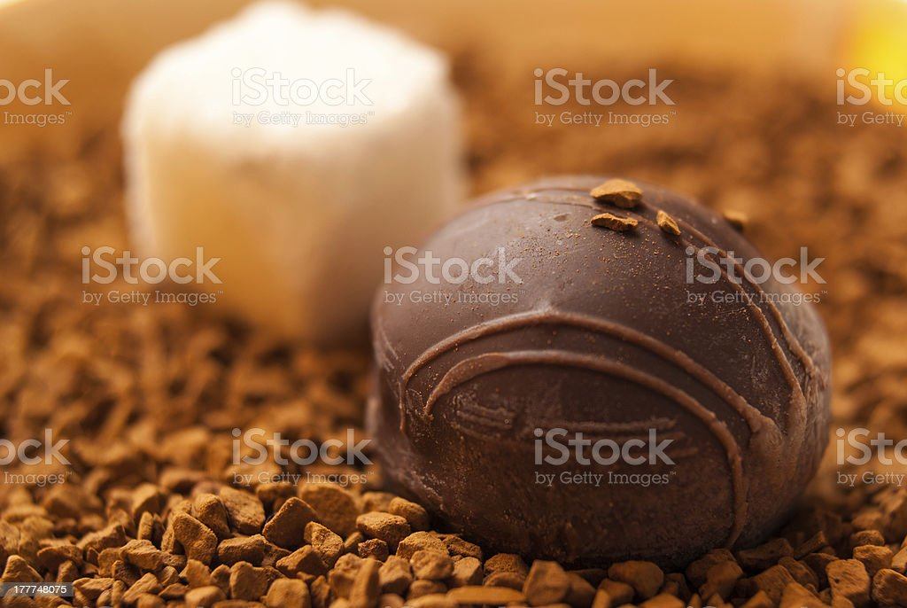 Chocolate candy and sugar cube royalty-free stock photo