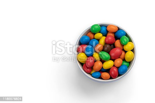 Chocolate candy in bowl isolated on white background