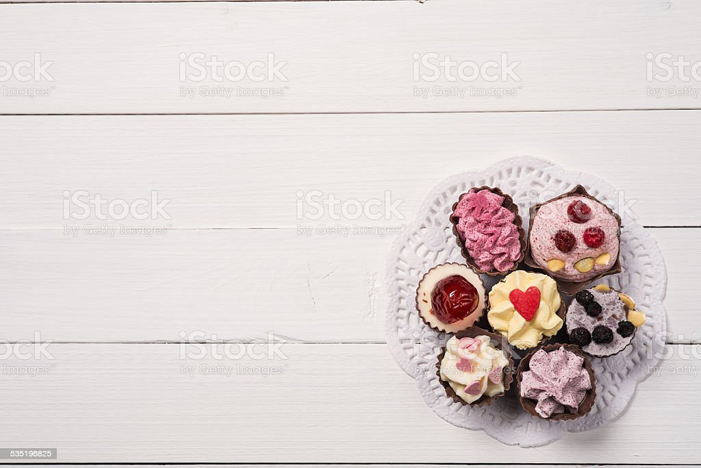 Chocolate candy on a paper napkin, top view stock photo