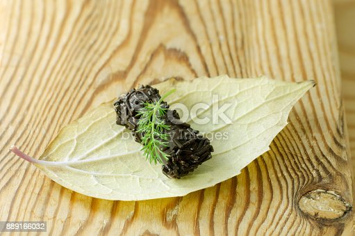 istock chocolate candy on autumn leaf, on a wooden counter 889166032