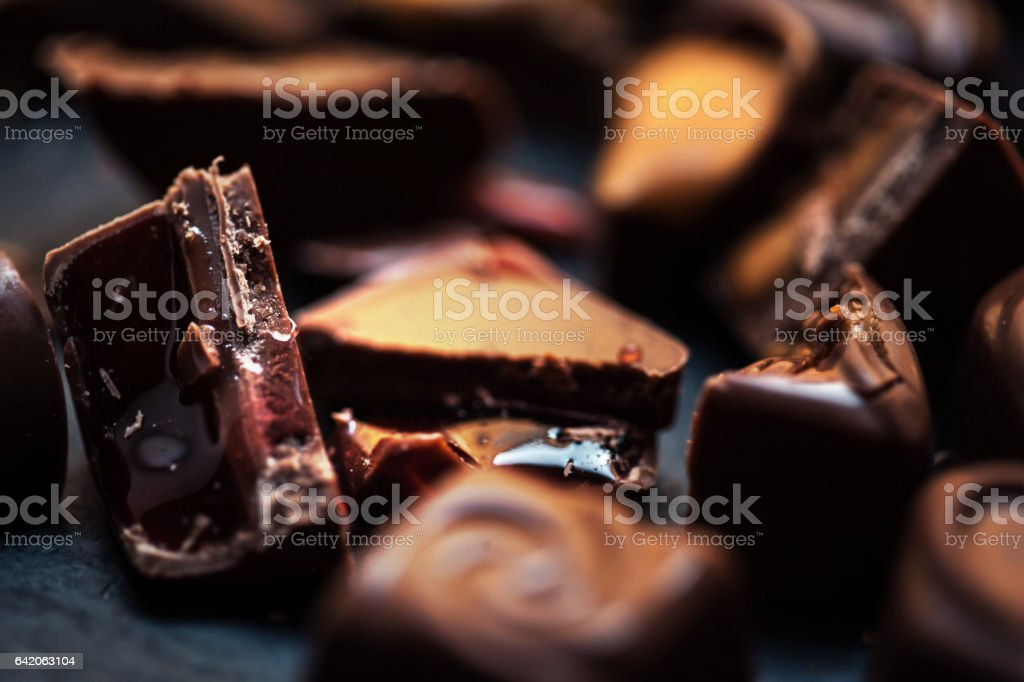 Chocolate Candy Sweet Wallpaper in high resolution. Dark chocolate stack, chips and powder. Set of Chocolate candies collection. stock photo