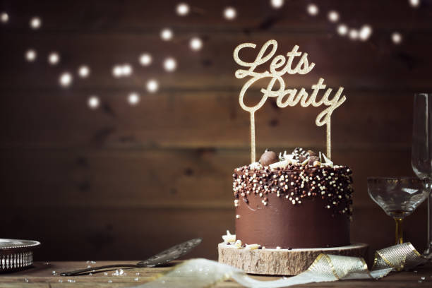 chocolate celebration cake - happy birthday banner stock photos and pictures