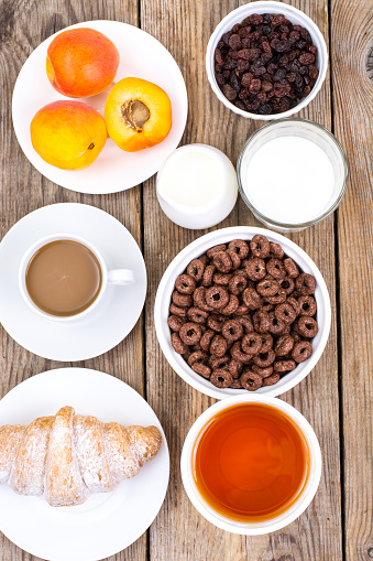840939766 istock photo Chocolate cereal flakes, coffee, milk, croissant and fruit for b 816303154