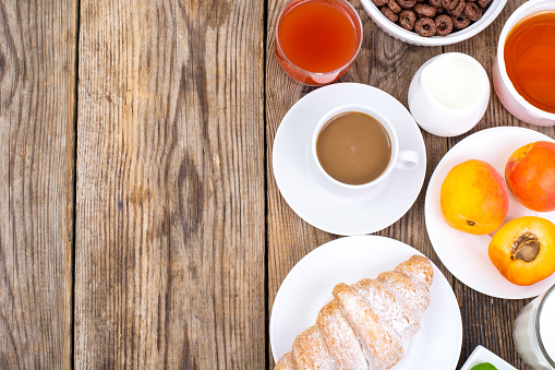 840939766 istock photo Chocolate cereal flakes, coffee, milk, croissant and fruit for b 816303192