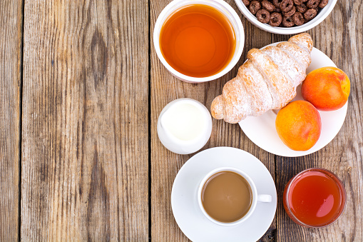 840939766 istock photo Chocolate cereal flakes, coffee, milk, croissant and fruit for b 816303260