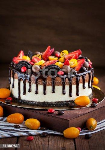 480972628 istock photo Chocolate cheesecake decorated with fresh fruits 514582872