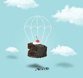 istock Chocolate cherry cake with parachute on blue sky 1070843744