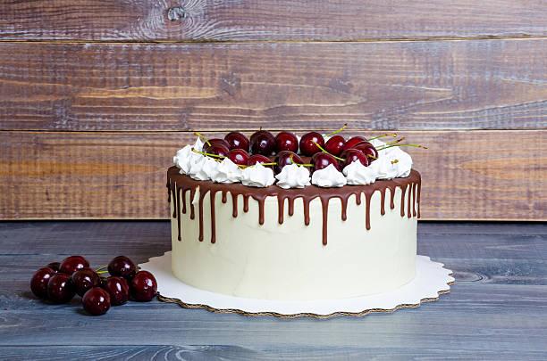 chocolate cherry cream cheese cake and crispy merengues stock photo