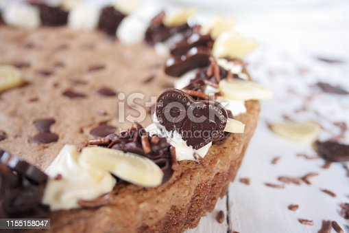 Chocolate chip cookie cake on white background