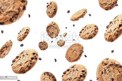 Chocolate chip cookie falling isolated on white background. Selective focus
