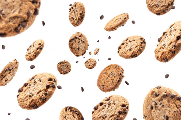 Chocolate chip cookie falling isolated on white background. Selective focus Chocolate chip cookie falling isolated on white background. Selective focus cookie stock pictures, royalty-free photos & images