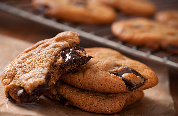 chocolate chip cookie - sticky stock pictures, royalty-free photos & images