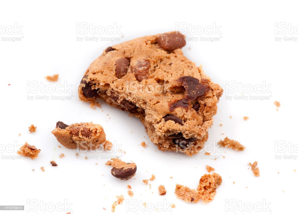 A chocolate chip cookie which has been partly eaten stock photo