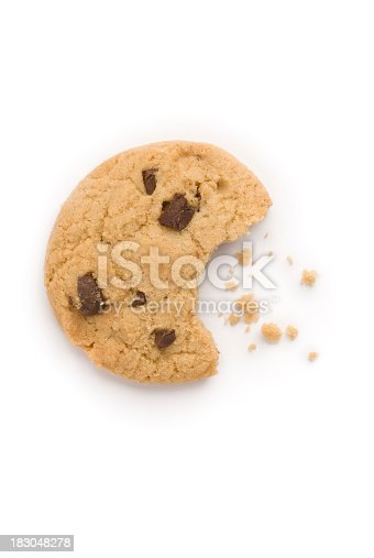 A studio shot of a biscuit with a bite taken out and crumbs, shot from above and isolated on a white background. The shape of the bite is in the shape of a mouth eating the crumbs