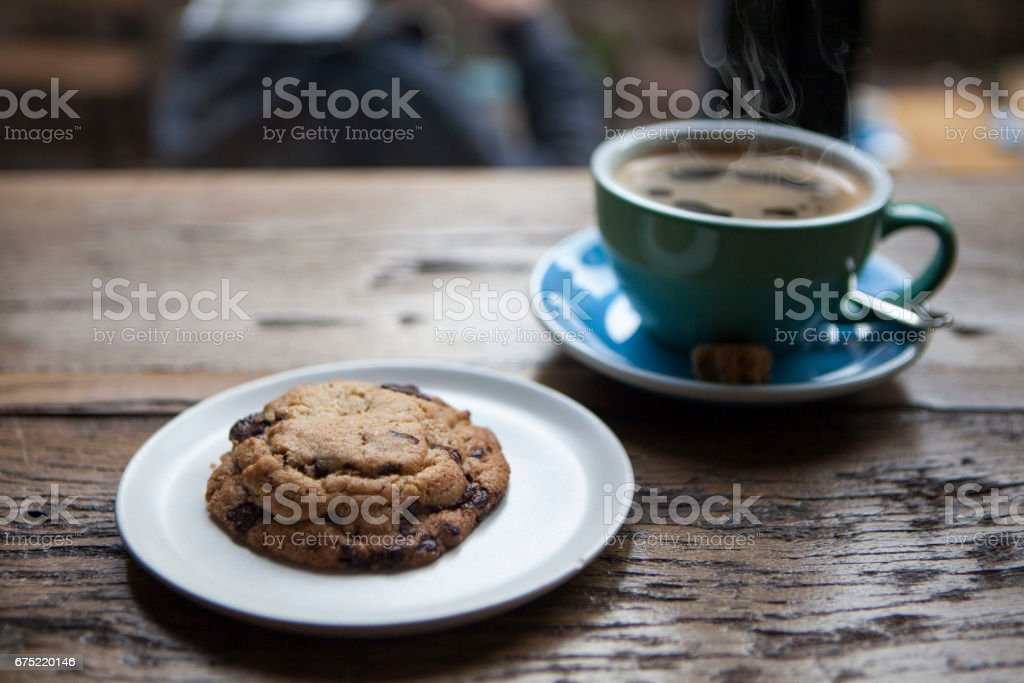 Chocolate chip cookies and a cup of coffee royalty-free stock photo