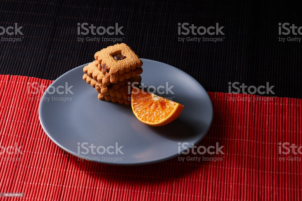 chocolate chip cookies and orange on gray plate and on style red with black table - Royalty-free Autumn Stock Photo