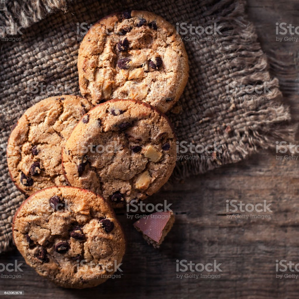 Chocolate chip cookies,  freshly baked on rustic wooden table. Selective Focus. Copy space. stock photo