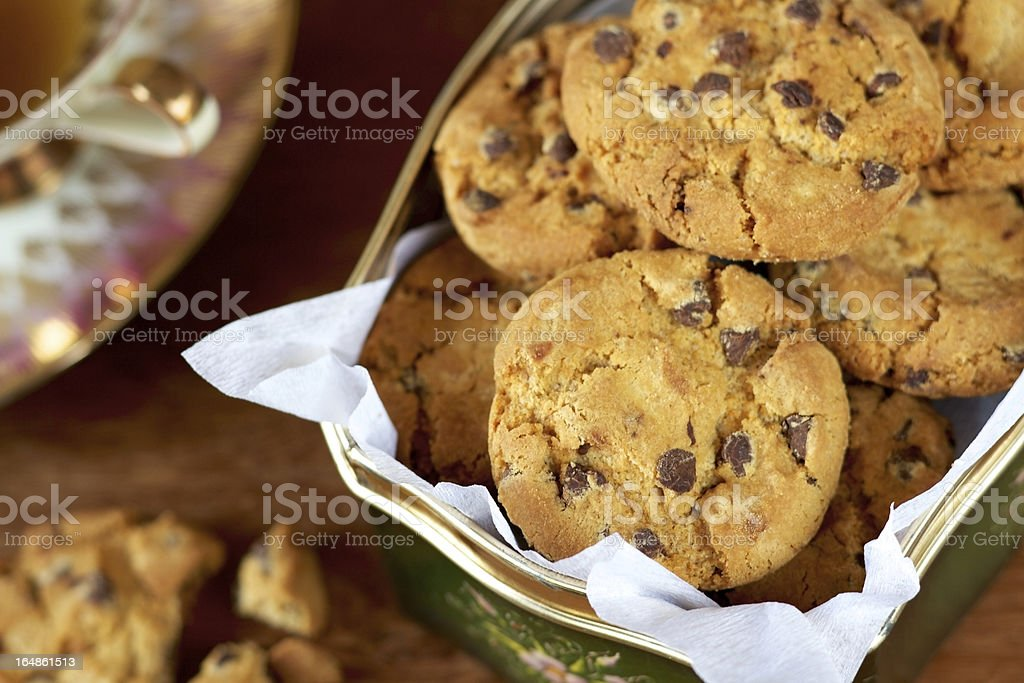 Chocolate chip cookies in a biscuit tin royalty-free stock photo