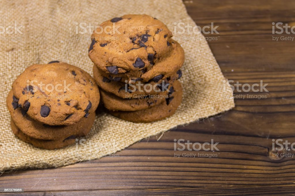 Chocolate chip cookies on wooden table stock photo
