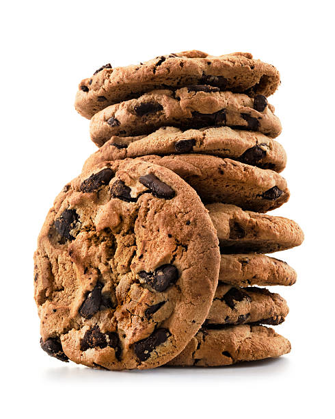 Chocolate chip cookies Pile of chocolate chip cookies against white background.  medium group of objects stock pictures, royalty-free photos & images