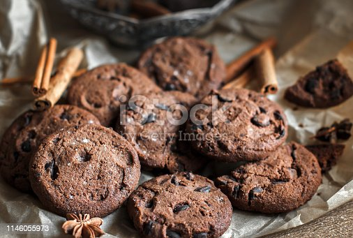 istock chocolate chip cookies with chocolate. Chocolate chip cookies. Dark food photography. - Image 1146055973