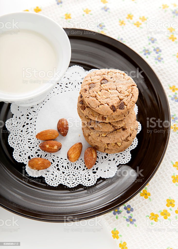Chocolate chip cookies with milk in cup stock photo