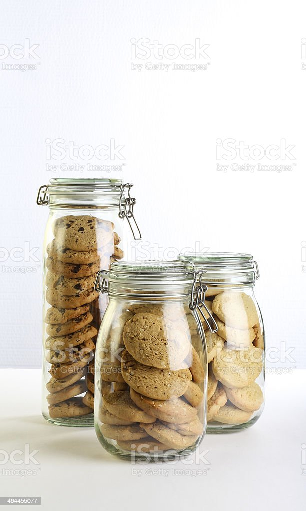 Chocolate chip, lavender and hazelnut cookies in jars royalty-free stock photo