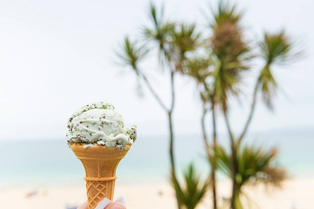 chocolate chip & mint ice cream cone - ice cream cone stock photos and pictures