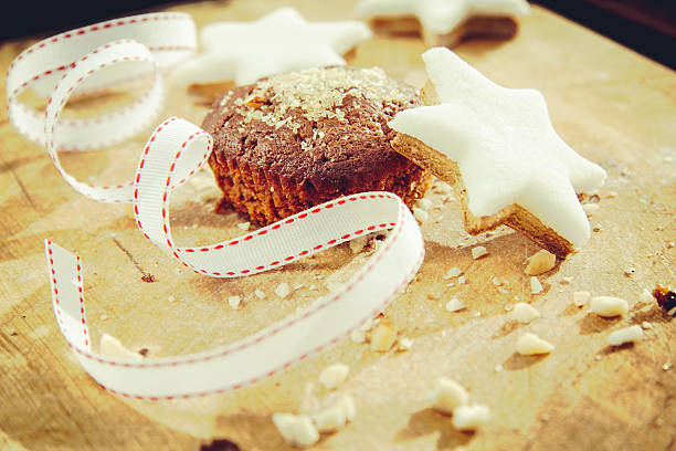 Chocolate Chip Muffin and Star Shape cookies stock photo