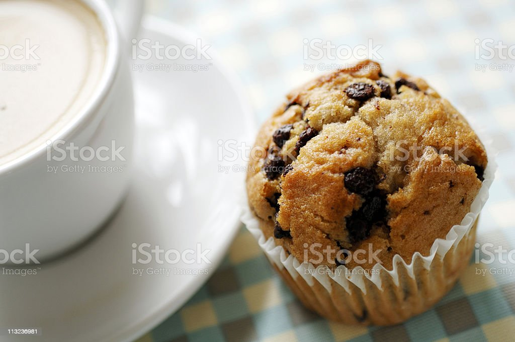 chocolate chip muffin with cup of coffee royalty-free stock photo