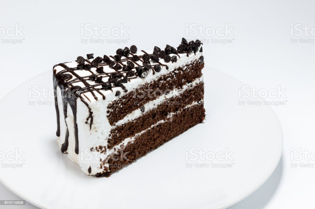 chocolate chip topping on chocolated cake on white background 免版稅 stock photo