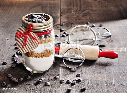 istock Chocolate chips cookie mix in a glass jar. 504101370